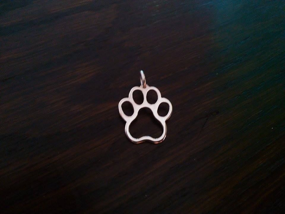 paw pendant sterling silver handmade by saw piercing