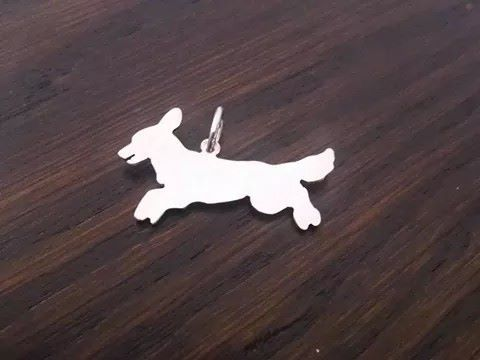 springing springer spaniel dog pendant sterling silver handmade by saw piercing Caroline Howlett Design